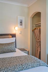 A bed or beds in a room at Silver Fern Rotorua - Accommodation & Spa