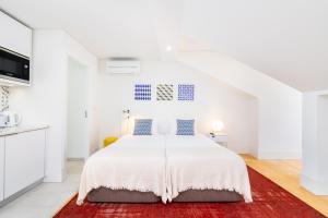Cama o camas de una habitación en Porta do Mar | Deluxe Serviced Apartments