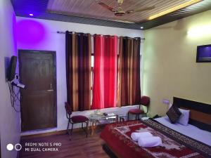 A seating area at Hotel Deepraj