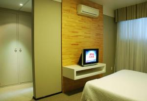 A television and/or entertainment center at Planalto Hotel