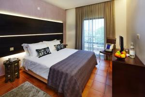 A bed or beds in a room at Hotel Parque das Laranjeiras