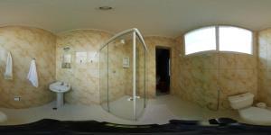 Um banheiro em Pousada Convento Da Penha