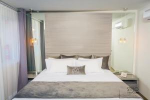 Cama o camas de una habitación en Hotel Modelo Buisness Class