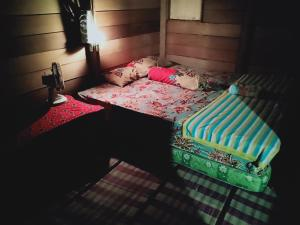 A bed or beds in a room at Rumah Pohon