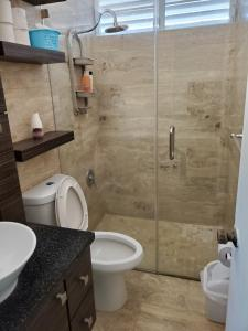 A bathroom at Beach Front Apt 5 at Isla Verde Tower