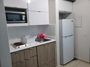 A kitchen or kitchenette at Beach Front Apt Isla Verde Ave