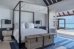 A bed or beds in a room at Four Seasons Resort Maldives at Landaa Giraavaru