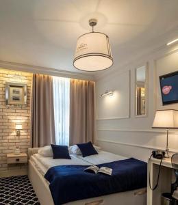 Łóżko lub łóżka w pokoju w obiekcie Willa Legenda Hotel & Mini Spa - Adults Only