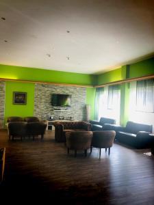 Ein Sitzbereich in der Unterkunft Parkhotel Schotten