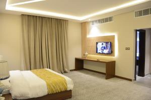 تلفاز و/أو أجهزة ترفيهية في الايوان للاجنحة الفندقية