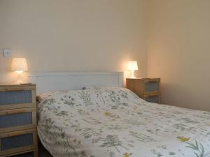 A bed or beds in a room at Pinecliffe Avenue