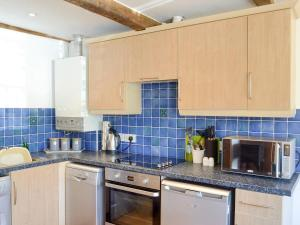 A kitchen or kitchenette at White Wing