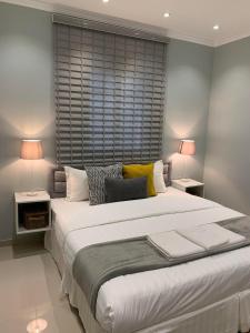 Cama ou camas em um quarto em Mila Hotel