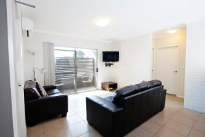 A seating area at Bluegum Apartments Newcastle
