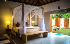 A bed or beds in a room at The Spice Trail