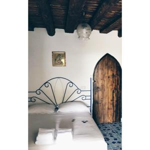 A bed or beds in a room at Domus Agricolae Corallina