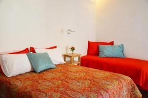 Кровать или кровати в номере Casa Oniri Hotel Boutique