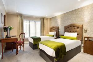 Un ou plusieurs lits dans un hébergement de l'établissement Drury Court Hotel