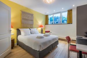 Een bed of bedden in een kamer bij The Old Lady