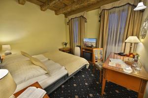 Un ou plusieurs lits dans un hébergement de l'établissement Hotel U 3 Pstrosu