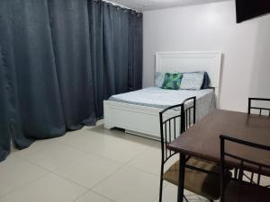 A bed or beds in a room at Beach Front Apt Isla Verde Ave