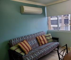 A seating area at Beach Front Apt 5 at Isla Verde Tower