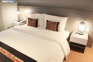 A bed or beds in a room at The Green Forest Resort