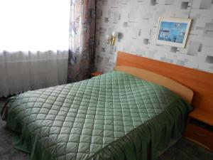 A bed or beds in a room at Jeruzale Hotel