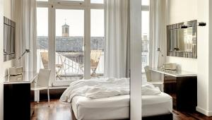 A bed or beds in a room at The Pure, a member of Design Hotels