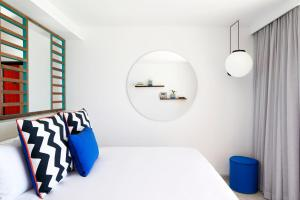 A bed or beds in a room at SALT of Palmar, an adult-only boutique hotel