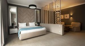 A bed or beds in a room at Flowers Hotel