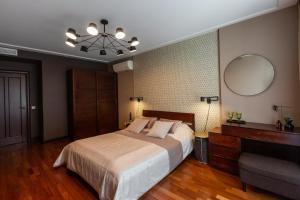Кровать или кровати в номере Sharf Hotel