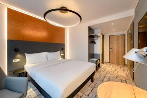 A bed or beds in a room at ibis Styles Bamberg