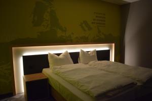 Ein Bett oder Betten in einem Zimmer der Unterkunft House of Records