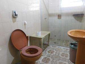 Um banheiro em Hostel Na Praia - Hospedagens e eventos