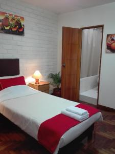 A bed or beds in a room at Miraflores Centre