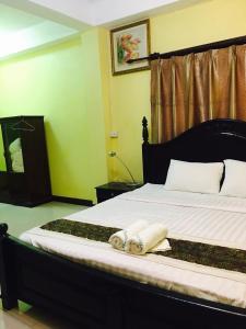 Un ou plusieurs lits dans un hébergement de l'établissement Thoulasith Guesthouse
