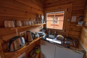 A kitchen or kitchenette at Dimmuborgir Guesthouse