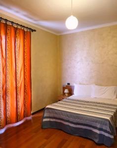 Letto o letti in una camera di Albergo Leon d'Oro
