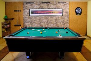 A pool table at Vila Horal