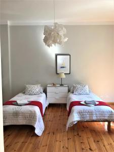 Łóżko lub łóżka w pokoju w obiekcie Apartament Żeglarski