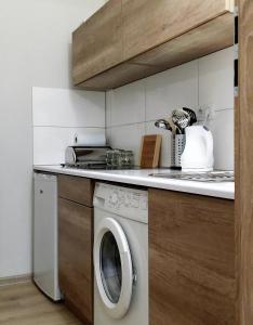 Kuchnia lub aneks kuchenny w obiekcie Apartament Żeglarski