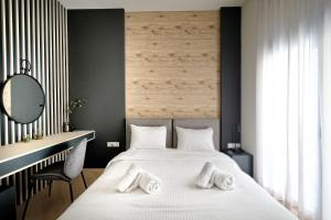 A bed or beds in a room at Muses Residence