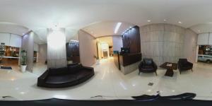 The lobby or reception area at Hotel Minas