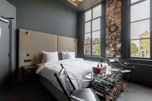 A bed or beds in a room at Hotel The Craftsmen