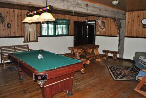 A billiards table at Aspen Inn