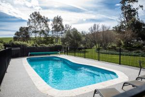 The swimming pool at or near Loves Lane Cottages
