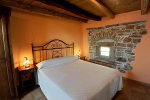 Кровать или кровати в номере Marica