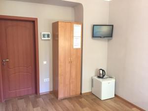 Телевизор и/или развлекательный центр в Отель Виктория
