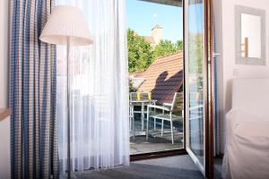 A balcony or terrace at Hotel Agneshof Nürnberg